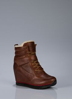 Leather + shearling lined wedge booties.  The perfect junction of the sneaker wedge, bootie, meets whiskey leather.