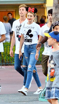 Gigi Hadid at Disneyland in a Mickey graphic t-shirt, ripped jeans, and sneakers