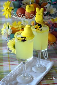 Lemon Peeptinis- 6 ozs lemon-flavored vodka (a.k.a. Citron), 2 ozs triple sec, 4 tbsps freshly squeezed lemon juice, 2 tsps simple syrup, or to taste (equal amounts of sugar and water heated until sugar dissolves), 2 cups ice. Fill a martini shaker or a large glass with ice. Add vodka, Cointreau, lemon juice and simple syrup and shake or stir. Strain into chilled martini glasses. Garnish with a candy lemon drop, a lemon twist or a peep on a skewer. Would also be cute with lemonade.