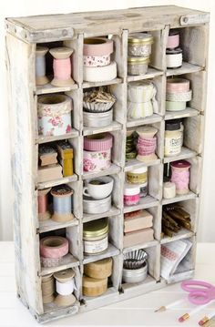Ohhh so shabby chic is this vintage wooden soft drink crate from days gone by. The crate has been painted with an awesome creamy white paint. All of the individual compartments are loaded with lots of shabby chic decorated items. I ♥ Love ♥ this awesome crate and photo from Stampington and found on LilyBean Paperie.