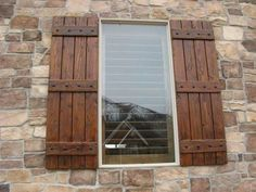 Rustic window shutters on the front of my home would add wonderful character and curb appeal. This brown paint color is perfect.