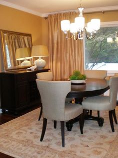subtle gold-yellow producing a sophisticated, affluent looking dining room.- I would add pops of orange instead of green and swap out the chairs for either all chocolate brown or a fun orange pattern.