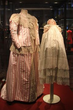 Maternity costume, belonged to Empress Alexandra Feodorovna, 1898-99. Baby dress, belonged to Tsarevich Alexei Nikolaevich. From the State Hermitage Museum.