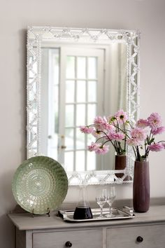 Venetian mirror trimmed with glass ribbons and rosettes. Handmade in Italy.