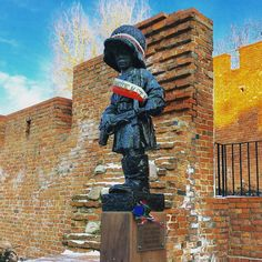 """Mały Powstaniec (the """"Little Insurrectionist"""") is a #statue in #commemoration of the #child #soldiers who fought and died during the #Warsaw Uprising of 1944. It is located on #Podwale Street next to the ramparts of Warsaws Old Town. #history #fact #WW2 #Poland #IgersWarsaw #IgersPoland #culture #art #sculpture #travel #tourism #tourist #education #leisure #life #war #peace"""