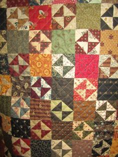 """Had to double check this wasn't mine!  Have one with same pattern (because I didn't want to make 200 """"Broken Dishes"""" blocks, so only had to make 100 using solid fabric between).  However, mine is quilted differently."""