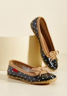 <p>The weather won't stop you from feeling winsome while you run errands in these polka-dotted rain shoes! Wonderfully waterproof, these black slip-ons star camel and white speckles, leather trim, and treaded soles that assure some spirited steps past the puddles!</p>
