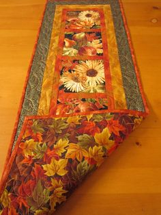 Fall Harvest Quilted Table Runner,  to use up all that fall harvest fabric I have laying around....
