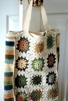 Crochet Granny Square Design Granny Greenbag designed by Ellen Bloom ~ interesting she covers a canvas bag with crocheted squares and side rows - from the book Craft Activism by Joan Tapper and Gale Zucker Bag Crochet, Crochet Shell Stitch, Crochet Diy, Crochet Amigurumi, Crochet Handbags, Crochet Purses, Love Crochet, Crochet Crafts, Crochet Clothes