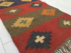 Inspired by the Spanish Colours, this rug shows the excellent craftscraftsmanship and mix of bold Colours. Handmade in India. Various Sizes available. You can choose a small, medium or a long runner. Add more Colour to your home decor.