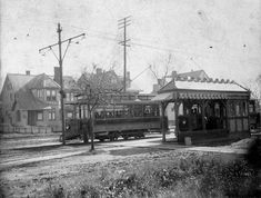 New Orleans and Carrollton Rail Road Company streetcars and transfer station, 1901.The original photograph carries this note:View of normal condition surrounding transfer point at Carrollton Ave. & Poplar [now Willow] St. from upper side of street--with rear of transfer house--showing two cars--with passengers going each way-- Photograph by Charles T. Yenni. From Civil District Court #62696 (Muller vs New Orleans and Carrollton Rail Road Co.)