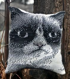 Tracy Widdess of Brutal Knitting created this fantastic knitted grumpy cat pillow with her electronic knitting machine.