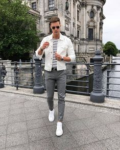 Men's White Denim Jacket, White and Navy Horizontal Striped Crew-neck T-shirt, Grey Chinos, White Low Top Sneakers Komplette Outfits, Casual Outfits, Casual Jeans, Simple Outfits, Men Sunglasses Fashion, Mens Sunglasses, Vintage Summer Outfits, Spring Outfits For Men, Grey Chinos