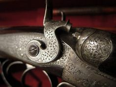 With back-action hammer locks and extra-best 'Royal' engraving, it is a late black powder rifle of the very highest quality.