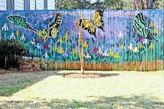 Gorgeous butterfly mural on the fence!  I want to do this so terribly badly!!!!  Like Drew Barry Moore to a garage in 50 first dates!