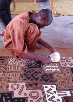 Hand-painting mudcloth in Mali.