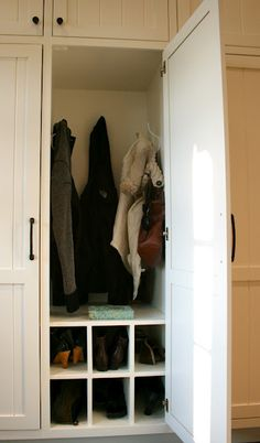 Mudroom/sunroom storage continued- each family member gets a spot for 3-4 coats (all seasons ;-), and room for 6 shoes/boots/sneakers/flip flops GENIUS!!!