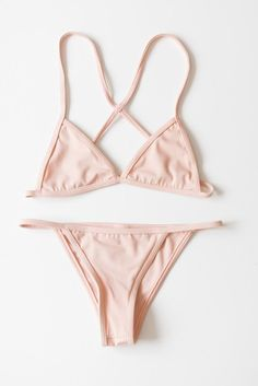 Simple and minimal triangle bikini top with a cross back and cheeky string side bottoms. Fully lined. Comes in blush pink or white.  80% Nylon 20% Spandex Made