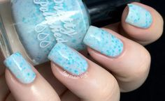 Pretty & Polished - Snowbound and Down  Snowbound and Down is a soft white crelly loaded with multi-sized hexes and dots in white and cool blue.