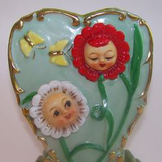 Vintage Anthropomorphic Flower Face Wall Pocket The birds tweet and the butterflies play, whilst the flower girls sing to the warmth of Summer's day.