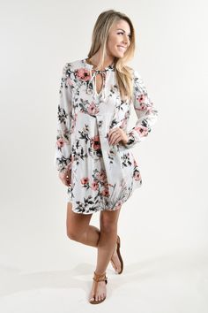 A beautiful ivory floral print dress! Fit: Looser fitting - no stretch. Material: 100% Polyester Model Stats: Morgan is 5'5'' a size 0 wearing a small. Measurements: Small: Bust 40'' Length 26'' Mediu