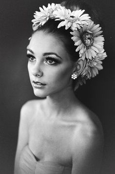 Pose, expression, flowers in hair