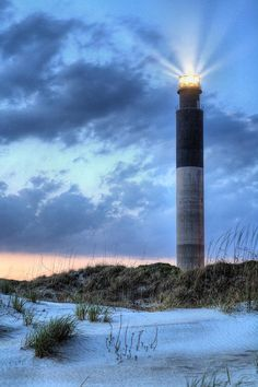✯ A perfect evening on Caswell Beach North Carolina as the Oak Island Lighthouse shines its warning of shallow water.