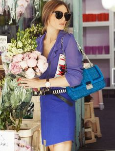 Olivia Palermo in a stunning mix of the violet blues of course acessorised with a Vogue magazine.