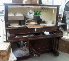 Piano converted for kitchen storage                              …