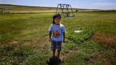 Derrin Yellow Robe, 3, stands in his great-grandparents' backyard on the Crow Creek Reservation in South Dakota. Along with his twin sister ...
