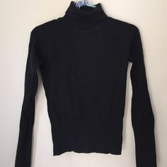 """Black turtleneck Stretch! Shoulder to bottom length is 19"""" so it could be a crop top if that's what you're going for. Ribbing detail at bottom of bodice and sleeves and around neck. Sweaters Cowl & Turtlenecks"""