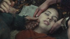 """""""She's going to be ok, right?"""" I barely whispered, afraid of the answer. I held the girl's face in my hands, desperately wishing for her eyes to open. He held his fingers to her neck, checking for a pulse. His eyes wouldn't meet my gaze. """"We need to get her to the village."""" I felt tears drip from my eyes. I couldn't lose her. She reminded me too much of Kilsa. She couldn't die."""