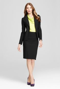 Want to liven up your outfit? Wear a bright blouse underneath that black suit!