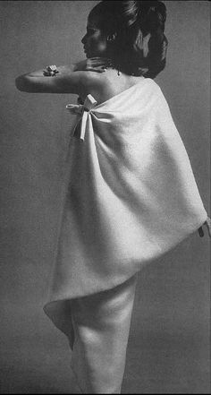 1967 Gloria Friedrich in an elegant white crepe evening dress by Givenchy, photo by William Klein for Vogue
