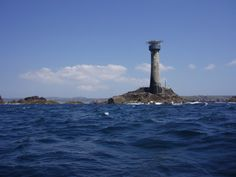 Longships Lighthouse is a navigation aid about 1.25mi off the coast of Lands End in Cornwall, England, UK. It stands on Carn Bras, the highest of the Longships islets which rises 39 feet above high water level. The lighthouse has been unmanned since 1988.