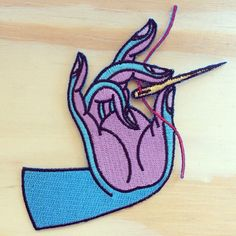 """This patch is based on a hand embroidered piece made in 2015. Machine embroidered with iron on backing. Measures approx. 4"""" across."""