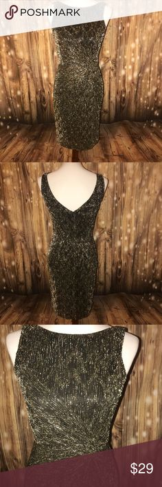 Women's Calvin Klein Twist Front Cocktail Dress EUC with zero flaws or signs of wear. Black with silver glitter design. Calvin Klein Dresses Mini