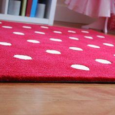 Red polka dot kids rug perfect for nursery, bedroom or playroom.