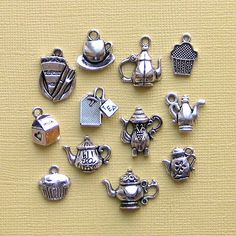 How 'bout these on Tea Coozies... too cute!  Tea Charm Collection Antique Tibetan Silver - 12 Different Charms - COL006. $3.95, via Etsy.