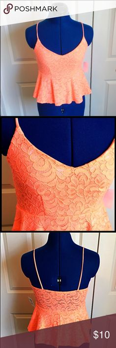 "Charolette Russe Lace Peplum Top Color is pinky/orange but was hard to capture with my camera because it is very bright! Peplum shape. Back panel above waist is see through lace. Stretchy. 98% nylon 2% spandex. Lining 100% polyester. Length shoulder to hem 21"". Bust 37"". Waist up to 32"". No trades. Make offer with offer button. Charlotte Russe Tops Tank Tops"