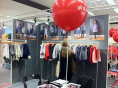 I love the images over the clothing that is hung on simple racks.