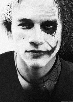 Heath Ledger [ this photo links to The Dark Knight YouTube video ]