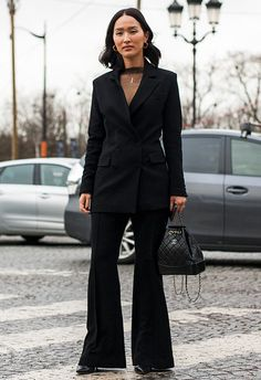 For a cool update on your professional style, swap out your regular suit for crisp, flared trousers. Keep accessories premium and add a leather backpack, pointed heels and minimal gold hoops. But the real desk-to-drinks winner? A sheer high-neck blouse poking out the top of the blazer for some sassy detail, or to steal-the-stares when the jacket comes off post-work