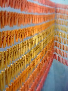 Detail of Anthropologie window display that incorporated painted wooden clothes pegs