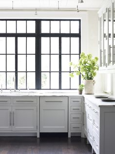 Kitchen 4 small copy.png.  dishwasher panel/hardware.  black windows and white cabinets