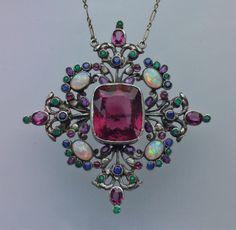 SIBYL DUNLOP 1889-1968 Arts & Crafts Pendant/Brooch   Silver Tourmaline Opal Emerald Sapphire Amethyst  H: 6.3 cm (2.48 in)  W: 6.3 cm (2.48 in)  British, c.1930 #TourmalineOpalPendant