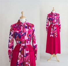 VINTAGE 70s MOD LOUNGEWEAR   This is such a cool garment it would really be a shame just to wear it around the house. The dress is shirtwaist style. The blouse is made of a lightweight polyester in a mod floral paisley print. The top buttons down the front and has long sleeves with a one button cuff. The skirt is made in a hot pink velour with two patch pockets and a front zipper. There is a sash that matches the blouse.    Item: Vintage 70s Loungewear    Material: Polyester and velour…