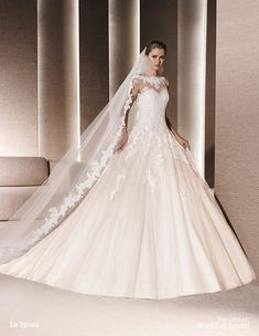 Princess dress in tulle with beige underlay decorated with lace and guipure appliqués. Sweetheart bodice with sheer illusion tulle overlay embellished with decorative lace and guipure appliqués. Plunging round back.