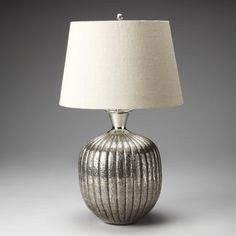 The curved Butler Hors Doeuvres Antique Nickel Table Lamp is ribbed and drenched in an antique nickel finish. This table lamp is capped by a cream linen. Dining Chairs, Dining Table, Metal Table Lamps, Contemporary Furniture, Butler, Lighting, Antiques, Modern, Home Decor