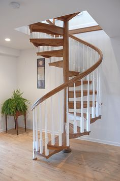 Get stair inspiration form our gallery of wood spiral staircases. From curved wood stairs to full spiral options, find out which stair style you prefer. Spiral Stairs Design, Home Stairs Design, Duplex House Design, Attic Design, Spiral Staircase, Small Loft Spaces, Small Loft Apartments, Stairs Upgrade, Stair Gallery